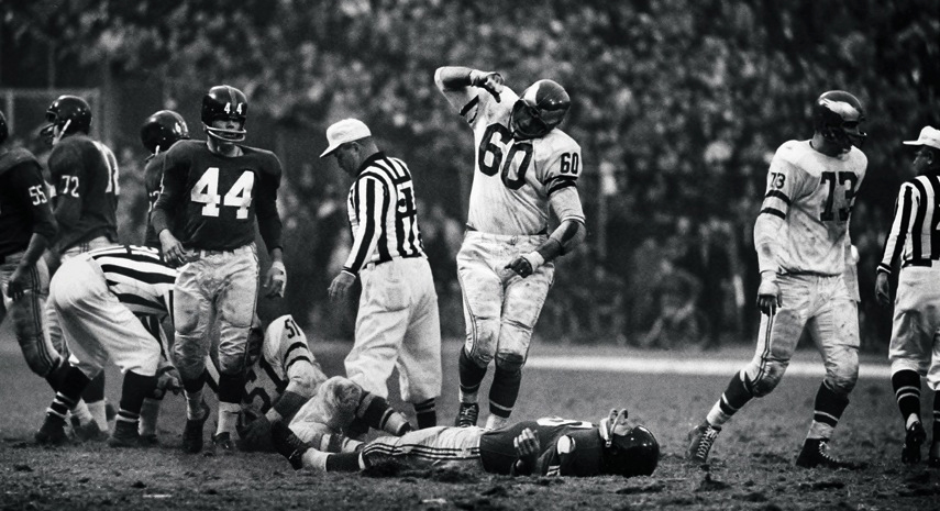 Philadelphia Eagles LB/C Chuck Bednarik (60) exults after hitting New York Giants Frank Gifford, who lays motionless beneath him; Yankee Stadium/New York, NY 11/20/60   Credit: John G. Zimmerman SetNumber: X7149